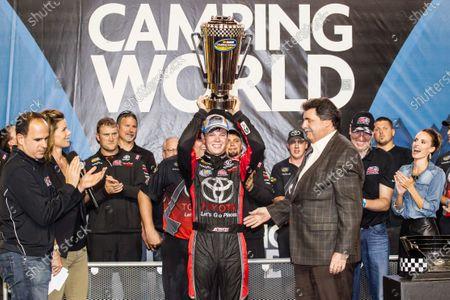 Championship victory lane: NASCAR Camping World Truck Series 2015 champion Erik Jones, Kyle Busch Motorsports celebrates with NASCAR President Mike Helton