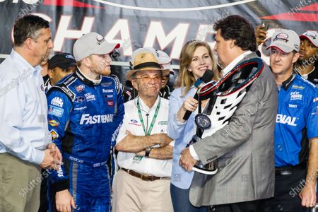 Championship victory lane: NASCAR XFINITY Series 2015 champion Chris Buescher, Roush Fenway Racing Ford celebratres with Jack Roush and NASCAR President Mike Helton