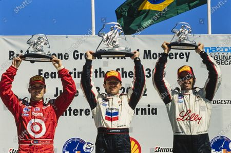 Cristiano da Matta, 1st position, celebrates on the podium with Christian Fittipaldi, 2nd position, and Kenny Bräck, 3rd position, on the podium.