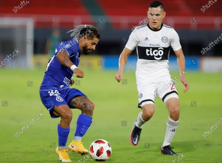 Stock Image of Cristian Esparza (L) of Sol de America vies for the ball with Diego Torres of Olimpia during their Clausura tournament seminfinals soccer match at Defensores del Chaco satadium in Asuncion, Paraguay, 27 December 2020.