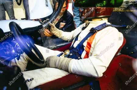 Jackie Oliver talks to Pedro Rodriguez as he sits in the cockpit of their John Wyer Automotive Engineering Porsche 917 LH.