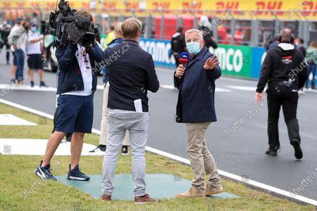 Simon Lazenby, Sky TV, and Johnny Herbert, Sky TV, on the grid