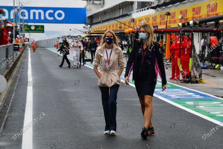 Stock Photo of Raquel Diniz, fiancée of Lawrence Stroll, and a Racing Point team member in the pitlane