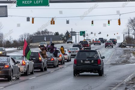 Members of the Andre' Hill Justice Caravan travel over a highway. Advocates against police brutality met up at Genoa Park in Columbus, Ohio to form a Black Lives Matter Car Caravan in reaction to police officer Adam Coy killing Andre' Hill on Tuesday Dec. 22, 2020. The Caravan started in Genoa and ended in Livingston Heights. This event was organized by Consistency Speaks and the Downtowners Collective in Columbus, Ohio.