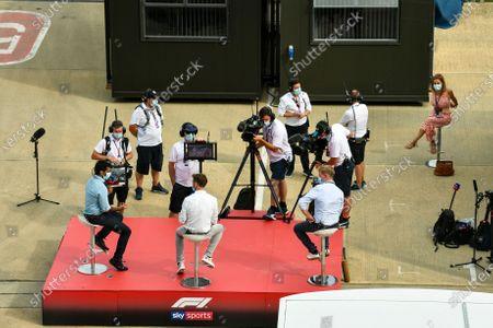 Karun Chandhok, Sky TV, Jenson Button, Sky Sports F1, and Simon Lazenby, Sky TV, on their socially distanced platform
