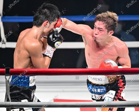 Stock Picture of (L-R) Hironori Mishiro, Masayuki Ito - Boxing : 10R lightweight bout at Sumida City Gymnasium in Tokyo, Japan.