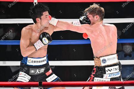 (L-R) Hironori Mishiro, Masayuki Ito - Boxing : 10R lightweight bout at Sumida City Gymnasium in Tokyo, Japan.