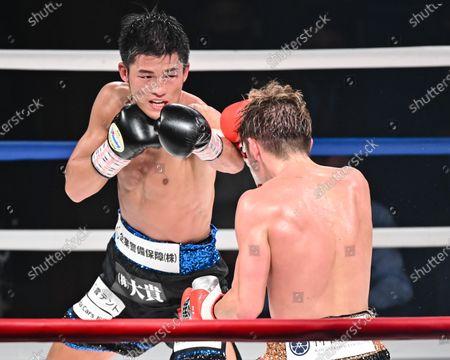 Stock Photo of (L-R) Hironori Mishiro, Masayuki Ito - Boxing : 10R lightweight bout at Sumida City Gymnasium in Tokyo, Japan.