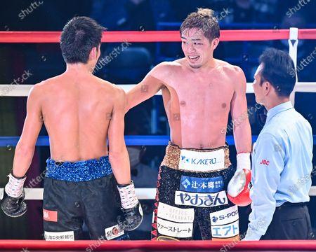 Stock Image of (L-R) Hironori Mishiro, Masayuki Ito - Boxing : 10R lightweight bout at Sumida City Gymnasium in Tokyo, Japan.