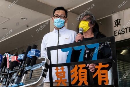 Former Democratic Party lawmaker Lam Cheuk-ting (C),  and Leung Kwok-hung (R), also known as Long Hair, talk to the press outside the Eastern Magistrates' Courts in Hong Kong, China, 28 December 2020. Lam was charged for allegedly disclosing the identity of a person under the investigation by the Independent Commission Against Corruption (ICAC) in relations to a July 2019 mob attack on bystanders in the suburb of Yuen Long.