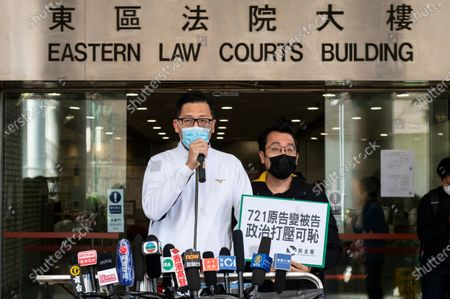 Lam Cheuk-ting (L), former Democratic Party lawmaker, talks to the press outside the Eastern Magistrates' Courts in Hong Kong, China, 28 December 2020. Lam was charged for allegedly disclosing the identity of a person under the investigation by the Independent Commission Against Corruption (ICAC) in relations to a July 2019 mob attack on bystanders in the suburb of Yuen Long.