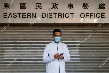 Lam Cheuk-ting, former Democratic Party lawmaker, stands outside the Eastern Magistrates' Courts in Hong Kong, China, 28 December 2020. Lam was charged for allegedly disclosing the identity of a person under the investigation by the Independent Commission Against Corruption (ICAC) in relations to a July 2019 mob attack on bystanders in the suburb of Yuen Long.