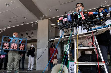 Stock Image of Lam Cheuk-ting (R), former Democratic Party lawmaker, talks to the press outside the Eastern Magistrates' Courts in Hong Kong, China, 28 December 2020. Lam was charged for allegedly disclosing the identity of a person under the investigation by the Independent Commission Against Corruption (ICAC) in relations to a July 2019 mob attack on bystanders in the suburb of Yuen Long.