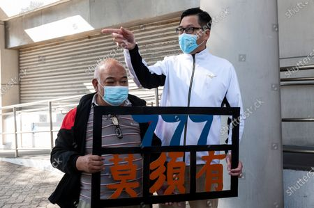 Lam Cheuk-ting (R), former Democratic Party lawmaker, stands outside the Eastern Magistrates' Courts in Hong Kong, China, 28 December 2020. Lam was charged for allegedly disclosing the identity of a person under the investigation by the Independent Commission Against Corruption (ICAC) in relations to a July 2019 mob attack on bystanders in the suburb of Yuen Long.