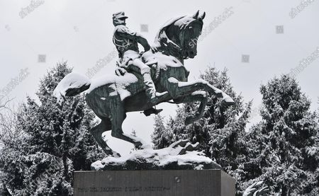 A view of a statue of Italian prince Amedeo Ferdinando di Savoia-Aosta created by Davide Calandra, during light snowfall in Turin, Italy, 28 December 2020. Amedeo Ferdinando di Savoia-Aosta (1845-1890) was the second son of Italian King Vittorio Emanuele II and became the only King of Spain from the House of Savoy in 1870 for three years.
