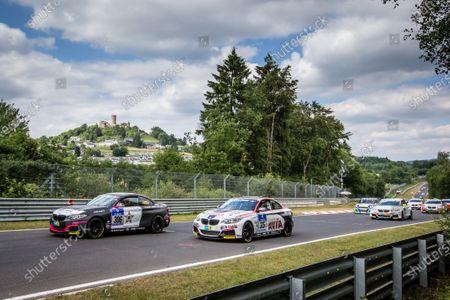 Start: #306 Team Ring Police BMW M235i Racing: Jean-Pierre Kremer, Jan-Erik Slooten and #315 Mathol Racing BMW M235i Racing: Andres Serrano, Volker Wawer