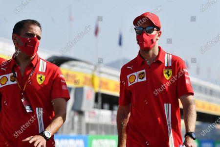 Sebastian Vettel, Ferrari, and Marc Gene walk the circuit