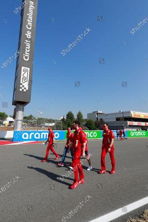 Sebastian Vettel, Ferrari, Marc Gene and other team members walk the circuit
