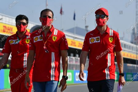 Sebastian Vettel, Ferrari and Marc Gene walk the track