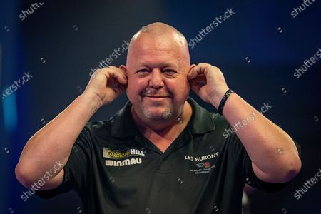 Mervyn King (England) reacts after his win during the William Hill World Darts Championship at Alexandra Palace, London