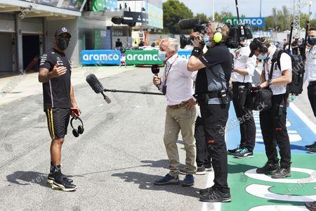 Lewis Hamilton, Mercedes-AMG Petronas F1, is interviewed by Johnny Herbert, Sky TV