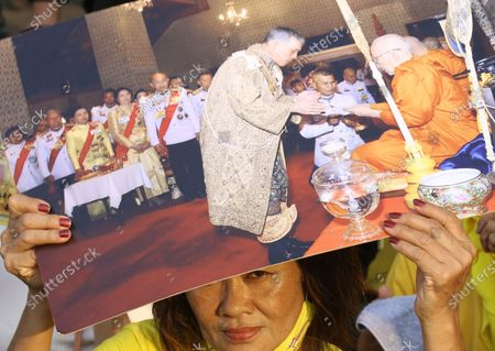 Well-wishers hold the portraits of Thai King Maha Vajiralongkorn Bodindradebayavarangkun, as they attend a ceremony to mark King Taksin Memorial Day in Bangkok, Thailand, 28 December 2020. King Taksin Memorial Day is celebrated on 28 December commemorating the day only king of the Thonburi Dynasty was crowned at Wang Derm Palace in Thonburi, the new capital of Siam in 1767.