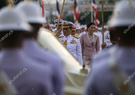 Thai King Maha Vajiralongkorn Bodindradebayavarangkun (C-L) walks next to Thai Queen Suthida Bajrasudhabimalalakshana (C-R)  to preside over the wreath-laying ceremony  of King Taksin's Day at the King Taksin Monument in Bangkok, Thailand, 28 December 2020. King Taksin Memorial Day is celebrated on 28 December commemorating the day only king of the Thonburi Dynasty was crowned at Wang Derm Palace in Thonburi, the new capital of Siam in 1767.
