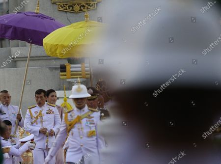 Thai King Maha Vajiralongkorn Bodindradebayavarangkun (L) walks next to Thai Queen Suthida Bajrasudhabimalalakshana  to preside over the wreath-laying ceremony  of King Taksin's Day at the King Taksin Monument in Bangkok, Thailand, 28 December 2020. King Taksin Memorial Day is celebrated on 28 December commemorating the day only king of the Thonburi Dynasty was crowned at Wang Derm Palace in Thonburi, the new capital of Siam in 1767.