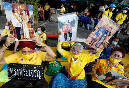 Well-wishers hold the portraits of Thai King Maha Vajiralongkorn Bodindradebayavarangkun and Thai Queen Suthida, as they attend a ceremony to mark King Taksin Memorial Day in Bangkok, Thailand, 28 December 2020. King Taksin Memorial Day is celebrated on 28 December commemorating the day only king of the Thonburi Dynasty was crowned at Wang Derm Palace in Thonburi, the new capital of Siam in 1767.