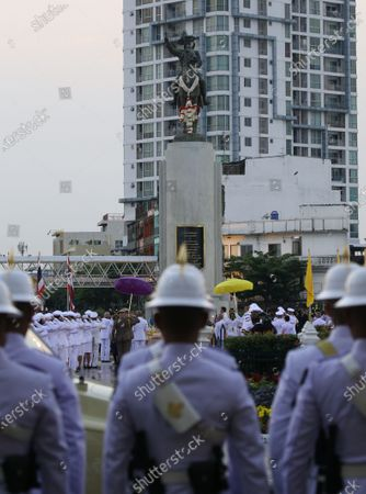 Stock Photo of Thai King Maha Vajiralongkorn Bodindradebayavarangkun (R) and Queen Suthida Bajrasudhabimalalakshana (L) during the wreath-laying ceremony  of King Taksin's Day at the King Taksin Monument in Bangkok, Thailand, 28 December 2020. King Taksin Memorial Day is celebrated on 28 December commemorating the day only king of the Thonburi Dynasty was crowned at Wang Derm Palace in Thonburi, the new capital of Siam in 1767.