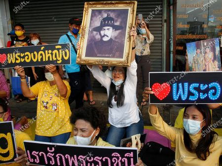 Well-wishers hold up a picture of King Taksin (C) and the portraits of Thai King Maha Vajiralongkorn Bodindradebayavarangkun and Thai Queen Suthida (R) as they attend a ceremony to mark King Taksin Memorial Day in Bangkok, Thailand, 28 December 2020. King Taksin Memorial Day is celebrated on 28 December commemorating the day only king of the Thonburi Dynasty was crowned at Wang Derm Palace in Thonburi, the new capital of Siam in 1767.