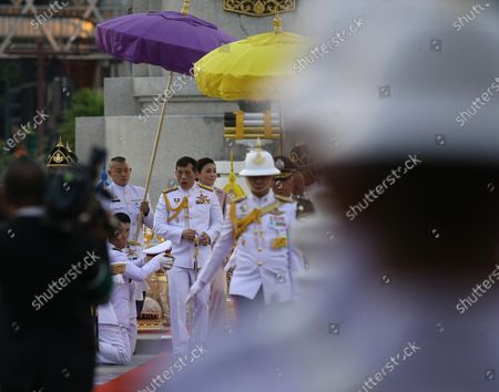 Stock Picture of Thai King Maha Vajiralongkorn Bodindradebayavarangkun walks next to Thai Queen Suthida Bajrasudhabimalalakshana (L)  to preside over the wreath-laying ceremony  of King Taksin's Day at the King Taksin Monument in Bangkok, Thailand, 28 December 2020. King Taksin Memorial Day is celebrated on 28 December commemorating the day only king of the Thonburi Dynasty was crowned at Wang Derm Palace in Thonburi, the new capital of Siam in 1767.