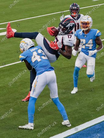 Stock Picture of Inglewood, CA, Sunday, December 27, 2020 - Denver Broncos wide receiver DaeSean Hamilton (17) leaps over Los Angeles Chargers cornerback Michael Davis (43) after a long pass from Drew Lock near the goal line, setting up the Bronos for a short touchdown run during second half action at SoFi Stadium. (Robert Gauthier/ Los Angeles Times)