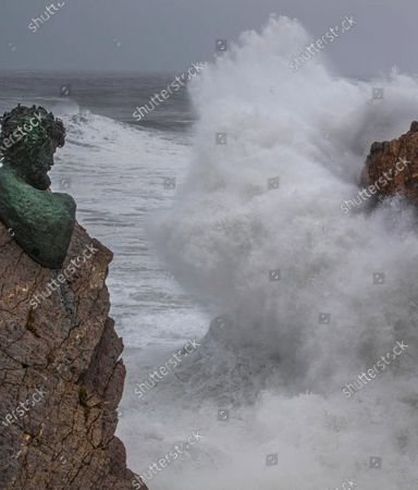 The waves hit the sculpture of Philippe Cousteau at the Anchor Museum of Salinas, Asturias, northern of Spain on 28 December 2020. Storm Bella will be leaving heavy rains and strong winds on its way through the country.
