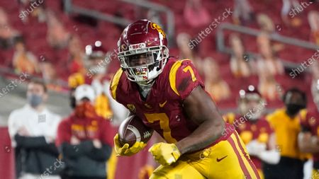 Stock Picture of Southern California running back Stephen Carr (7) runs the ball during the second half of an NCAA college football game for the Pac-12 Conference championship against Oregon, in Los Angeles