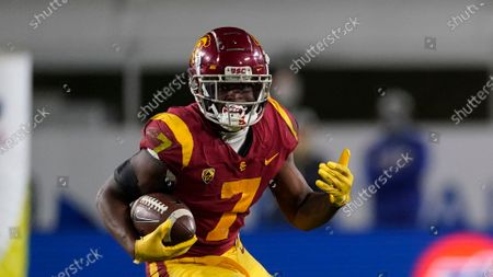 Stock Photo of Southern California running back Stephen Carr (7) runs the ball during the second half of an NCAA college football game for the Pac-12 Conference championship against Oregon, in Los Angeles