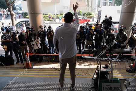 Former pro-democracy lawmaker Lam Cheuk-ting waves to the media outside the Eastern Magistrates' Court. Former opposition lawmaker Lam Cheuk-ting was arrested for allegedly disclosing the personal information of individuals being investigated by police in relation to the Yuen Long mob attacks last July. Officers from the Independent Commission against Corruption (ICAC) arrested the Democratic Party member at his home and brought him to North Point police station.