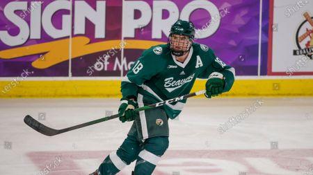 Bemidji State defenseman Brad Johnson (18) skates against Minnesota State during an NCAA hockey game, in Bemidji, Minn