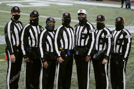 Stock Photo of Officials poses for a photograph before an football game between the New England Patriots and the Buffalo Bills, in Foxborough, Mass. From left they are umpire Mark Pellis, back judge Greg Yette, field judge James Coleman, line judge Jim Mello, referee Ron Torbert, side judge Jonah Monroe, and down judge Patrick Holt