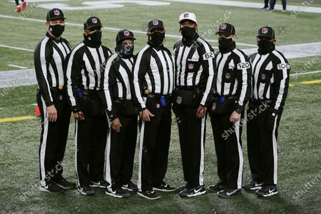 Stock Picture of Officials poses for a photograph before an football game between the New England Patriots and the Buffalo Bills, in Foxborough, Mass. From left they are umpire Mark Pellis, back judge Greg Yette, field judge James Coleman, line judge Jim Mello, referee Ron Torbert, side judge Jonah Monroe, and down judge Patrick Holt