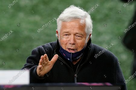 New England Patriots owner Robert Kraft waves to someone before an NFL football game against the Buffalo Bills, in Foxborough, Mass