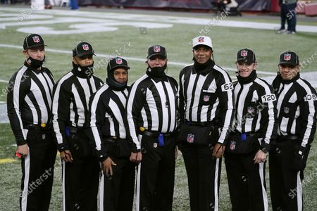 Officials poses for a photograph before an football game between the New England Patriots and the Buffalo Bills, in Foxborough, Mass. From left they are umpire Mark Pellis, back judge Greg Yette, field judge James Coleman, line judge Jim Mello, referee Ron Torbert, side judge Jonah Monroe, and down judge Patrick Holt