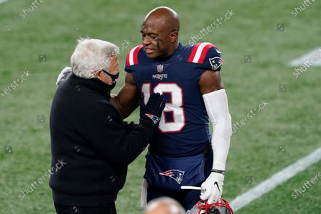 Stock Image of New England Patriots owner Robert Kraft, left, speaks to special teams captain Matthew Slater before an NFL football game against the Buffalo Bills, in Foxborough, Mass