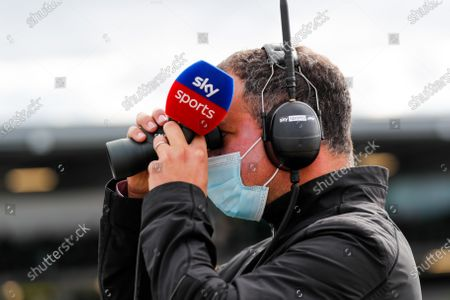 Martin Brundle, Sky TV, on the grid with binoculars