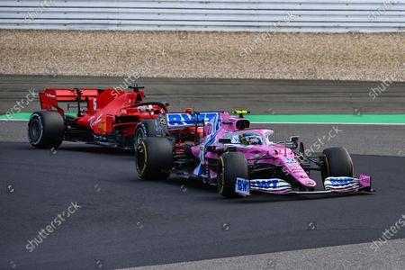 Nico Hulkenberg, Racing Point RP20, leads Sebastian Vettel, Ferrari SF1000
