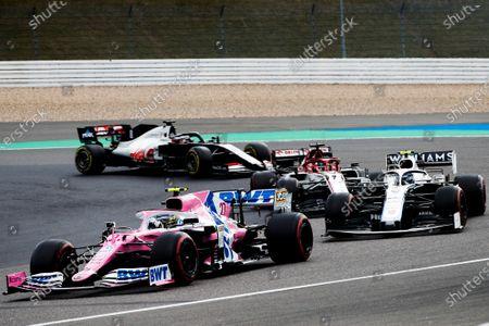 Nico Hulkenberg, Racing Point RP20, leads Nicholas Latifi, Williams FW43, Kimi Raikkonen, Alfa Romeo Racing C39, and Romain Grosjean, Haas VF-20