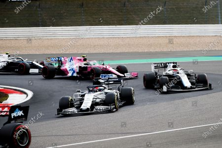 Daniil Kvyat, AlphaTauri AT01, leads George Russell, Williams FW43, and Nico Hulkenberg, Racing Point RP20, at the start