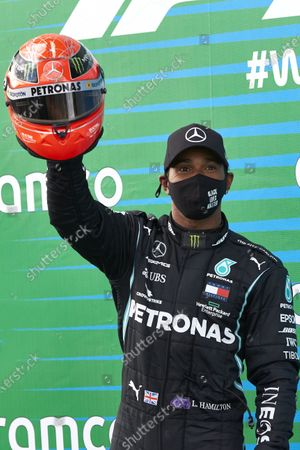 Lewis Hamilton, Mercedes-AMG Petronas F1, 1st position, with the helmet of Michael Schumacher after equalling his record 91 race wins