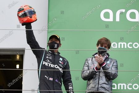 Lewis Hamilton, Mercedes-AMG Petronas F1, 1st position, on the podium with the helmet of Michael Schumacher after equalling his record 91 race wins