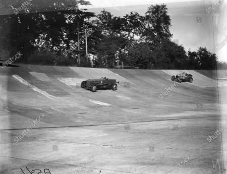 Stock Picture of J. G. Parry Thomas, Lanchester, leads Leon Cushman, Crossley, in the 100mph Long Handicap race.
